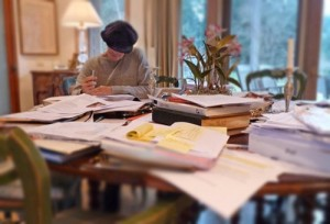 Linda writing at her table