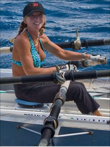 Roz Savage rowing in her boat