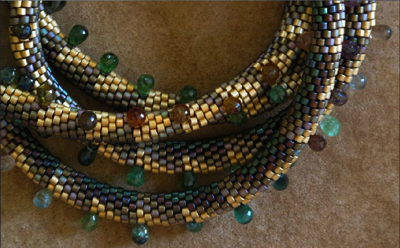Closeup of necklace by Claire Kahn