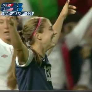 Alex Morgan celebrates after making the game-winning goal to beat Canada in the Olympic Semi