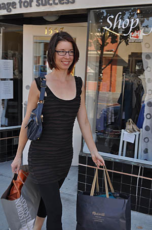 Ryan carrying her new wardrobe from Image for Success | Photo: Anita Gail Jones