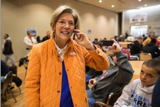 Elizabeth Warren speaking to a voter morning of 11/6/12 | Photo: Aram Boghosian