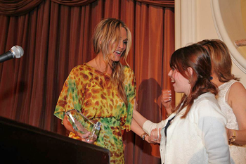 Claire Wineland receiving Soaring Spirit Award from Molly Sims/3/12/13