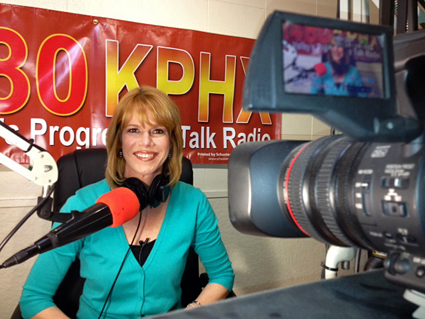 Stacey Gualandi, host of The Women's Eye Radio in the studio at 1480KPHX