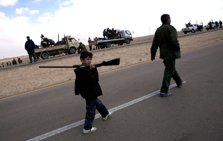 Libyan Boy with Gun | Photo by Heidi Levine/Sipa Press