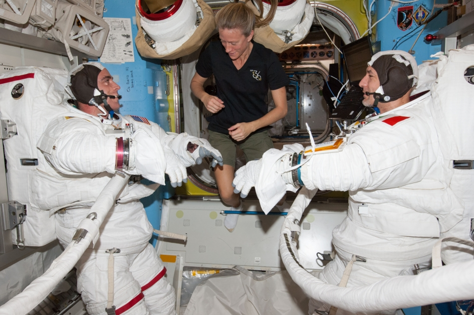 Astronauts Karen Nyberg and fellow astronauts at International Space Station/NASA