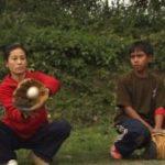 Woman in Manipur, India catching a baseball | Photo: Axel Baumann for Baseball Dreams