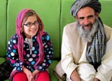 Farida, 11, with her father who was treated in the U.S. for the eye she lost during a Taliban bombing