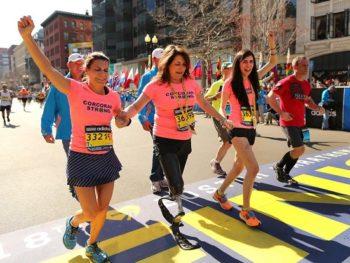Corcoran family crosses Boston Marathon finish line/2014/Boston Globe