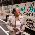 Estella Pyfrom standing in front of her Brilliant Bus