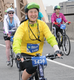 Patty Chang Anker riding her bike in the 40-mile 5 Boro Bike Tour in New York