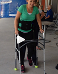 Paralyzed Olympic swimmer Amy Van Dyken-Rouen taking her first steps after her accident