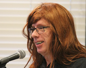 Sam Barry wearing a red wig to honor Kathi's red hair | Photo: Jim Shubin