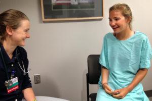Allie Tetreault talks to pretend patient Gabrielle Nuki at Maine Medical Center