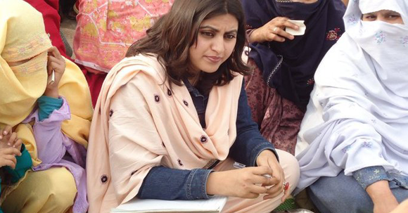Gulalai Ismail with flood victims in Nowshehra, Pakistan