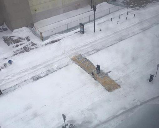Boston Finish Line shoveler/Boston Police Twitter