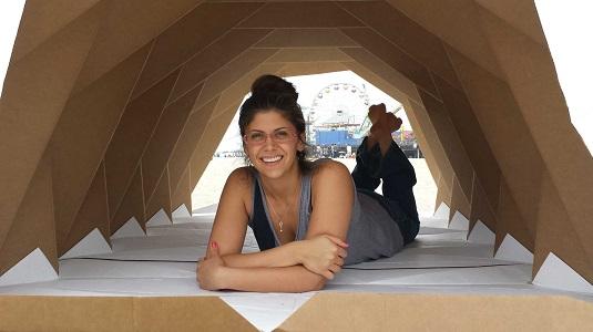 Tina Hovsepian inside her cardboragami shelter