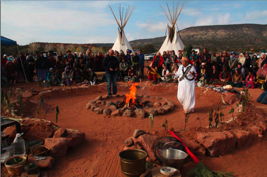 Paola Gianturco's photo of Napalese shaman Aama Bombo performing a ceremony for peace and grandmothers doing indigenous dance