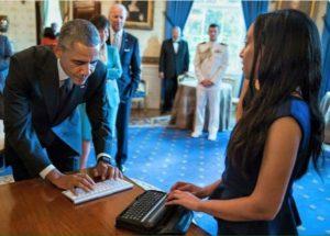 Haben Girma talking to President Obama using digital Braille device/White House Photo courtesy Haben Girma