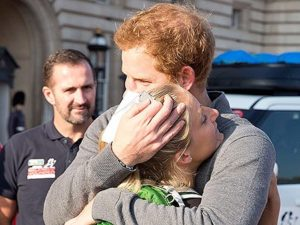 Prince Harry Embraces Wounded Warrior Kristie Ennis/Photo: People