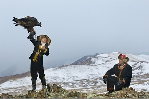 Aisholpan, winner of The GOlden Eagle Festival in The Eaqle Huntress with her father/Photo: Sony Classics