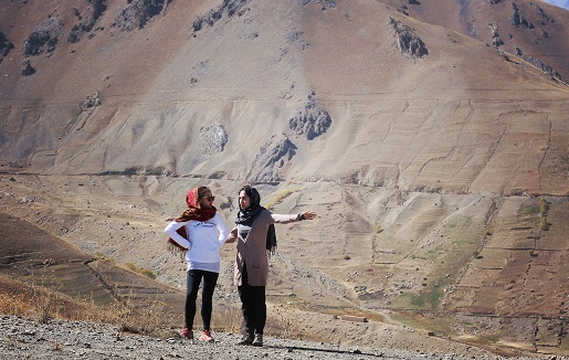 Jessica Wright, lawyer-maratoneer, with friend following an outdoor run in Bamiyan, Afghanistan/Photo Courtesy Jessica Wright