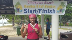 Lisa Davis, marathon runner at finish line in Singapore/Photo: Lisa Davis