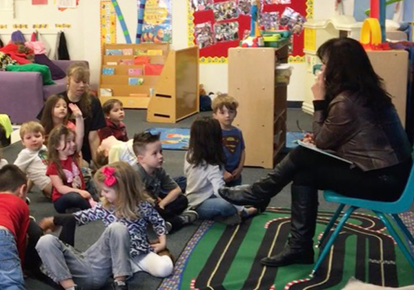 Theresa McKeown, author, reading to children/Photo provided to TWE by Theresa McKeown | The Women's Eye Magazine & Radio Show
