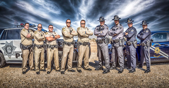 "Photo of Las Vegas first responders from Metro Police and Nevada Highway Patrol with fallen off-duty officer, Charleston Hatfield ""ghosted"" in (far left) 