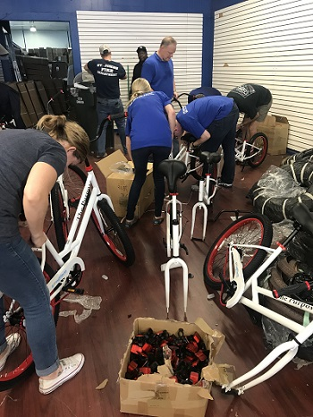 Going Places nonprofit putting bikes together in Charles, SC/Photo Courtesy Katie Blomquist