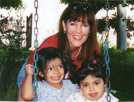 Nancy with orphans at El Salvador Orphanage
